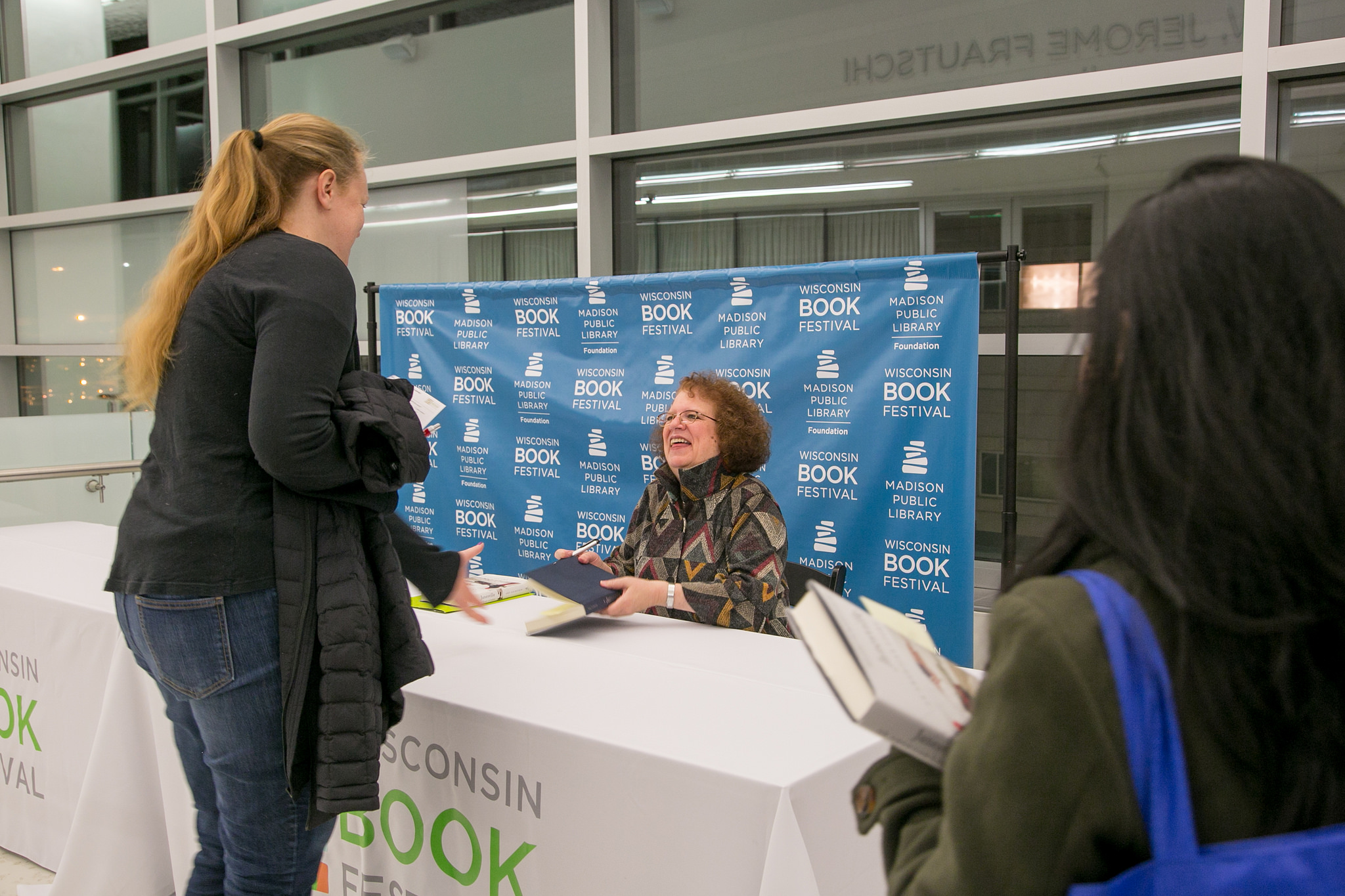 photo of Amy signing books at a Wisconsin Book Festival event